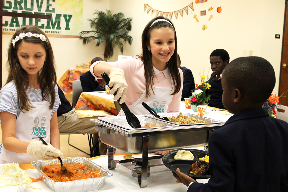 Girls Serve food to hungry children